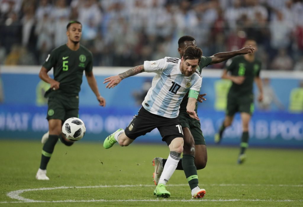 Argentina's Lionel Messi, front and Nigeria's Bryan Idowu, right, compete for the ball during the Group D match between Argentina and Nigeria on Tuesday in the St. Petersburg Stadium in St. Petersburg, Russia.
