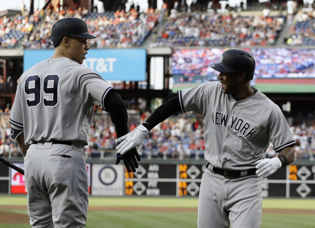 The Yankees' Aaron Hicks, right, and Aaron Judge celebrate after Hicks' home run off Phillies starter Jake Arrieta in the first inning Tuesday in Philadelphia. New York won 6-0.