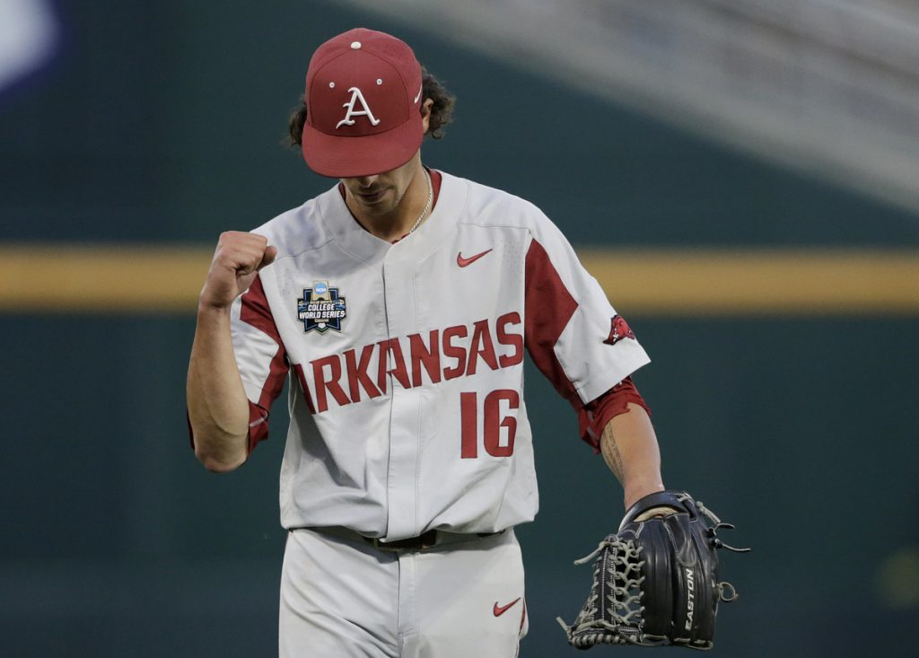 Arkansas pitcher Blaine Knight pumps his fist as he walks off the mound after the sixth inning of Game 1 of the NCAA College World Series against Oregon State Tuesday night in Omaha, Neb.