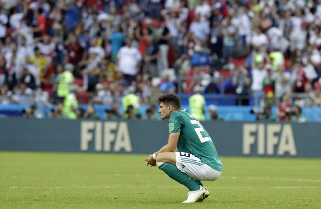 Germany's Mario Gomez kneels on the pitch after the match between South Korea and Germany, at the 2018 World Cup in Russia on Wednesday. The Koreans won, 2-0.