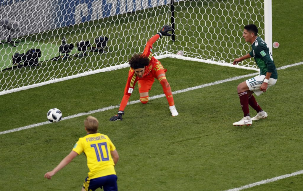 Mexico's Edson Alvarez scores an own goal past his goalkeeper during the match between Mexico and Sweden at the 2018 World Cup in Russia on Wednesday.