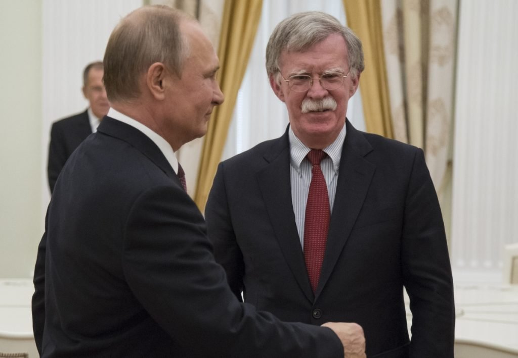 Russian President Vladimir Putin, left, meets with John Bolton, U.S. national security adviser, in the Kremlin Wednesday to finalize plans for a Putin-Trump summit.