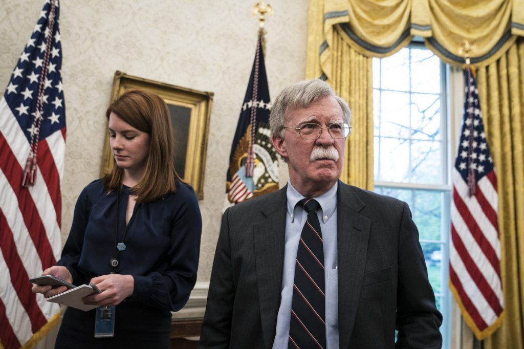 Cari Lutkins (left) and national security advisor John Bolton listen as President Donald Trump speaks during a meeting with Chancellor Merkel of Germany in the Oval Office at the White House on April 27, 2018. MUST CREDIT: Washington Post photo by Jabin Botsford.