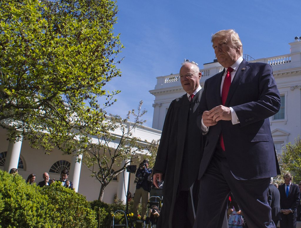 President Trump and Justice Anthony Kennedy walk together after Justice Neil Gorsuch was administered the oath of office on April 10, 2017.  Trump said he asked Kennedy for suggestions on his successor.