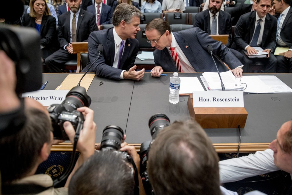 Deputy Attorney General Rod Rosenstein, right, and FBI Director Christopher Wray, left, arrive to testify before a House Judiciary Committee hearing on Capitol Hill in Washington, Thursday, June 28, 2018, on Justice Department and FBI actions around the 2016 presidential election. Associated Press/Andrew Harnik