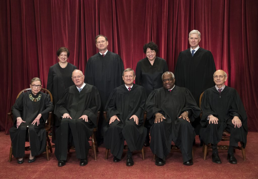In 2017 file photo, the justices of the U.S. Supreme Court gather for an official group portrait to include new Associate Justice Neil Gorsuch, top row, far right at the Supreme Court Building in Washington. Seated, from left are, Associate Justice Ruth Bader Ginsburg, Associate Justice Anthony M. Kennedy, Chief Justice John Roberts, Associate Justice Clarence Thomas, and Associate Justice Stephen Breyer. Standing, from left are, Associate Justice Elena Kagan, Associate Justice Samuel Alito Jr., Associate Justice Sonia Sotomayor, and Associate Justice Neil Gorsuch. The 81-year-old Kennedy is retiring after more than 30 years on the court.