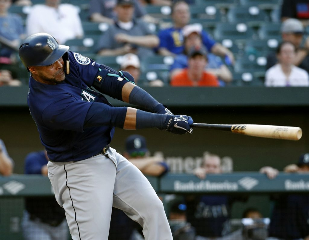 The Mariners' Nelson Cruz singles in the 10th inning Thursday at Baltimore. Seattle took advantage of two errors in the inning to come away with a 4-2 victory over the Orioles.