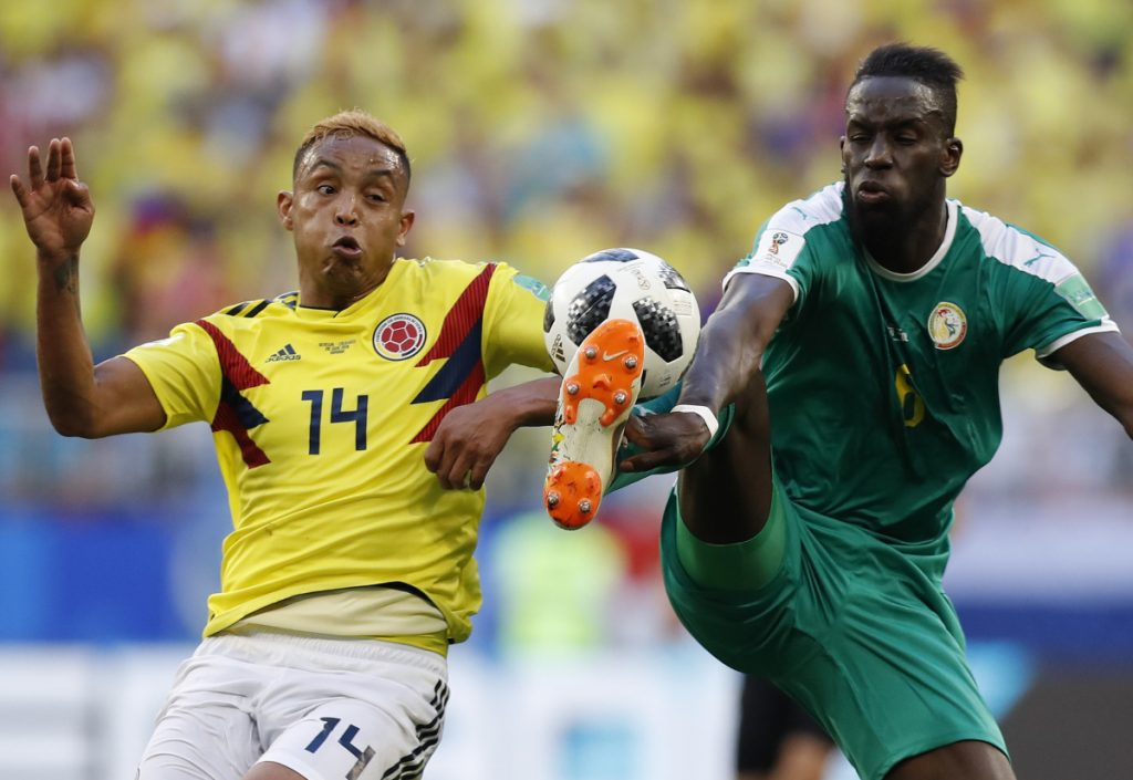 Salif Sane, right, and his Senegal teammates were moving out instead of moving on at the World Cup because they accumulated more yellow cards than Japan – a new tiebreaker.