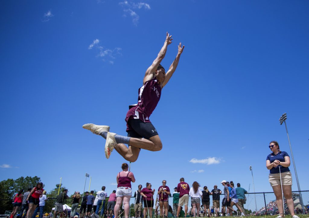 Cayden Spencer-Thompson of Mattanawcook competes in the triple jump at the Class C state championship track meet.