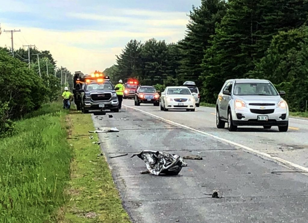 Shattered glass and debris from a 2002 Buick LeSabre are scattered on the side of Skowhegan Road as vehicles pass by the scene of a two-vehicle collision Friday morning in Fairfield. The LeSabre's owner, John Hamlin, 64, of Cornville, was driving toward Fairfield when police say he got a flat tire, causing him to cross the center line and strike the tractor-trailer.