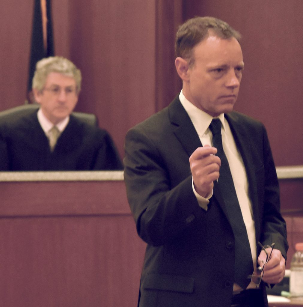 Assistant District Attorney Michael Madigan addresses the jury May 21 during the first day of Jeremy Clement's trial on charges of attempted murder in Kennebec County Superior Court. Behind Madigan is Justice William Stokes. Clement is scheduled to be sentenced Monday.