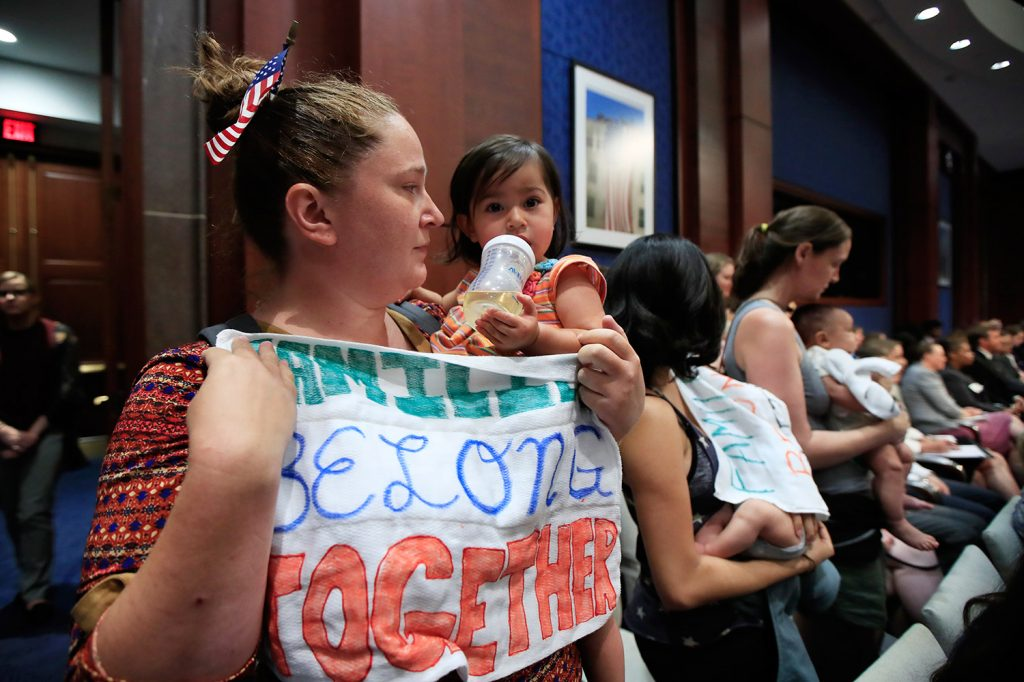 Lucy Martin and her daughter Branwen Espinal together with other mothers and their babies attend a House hearing to express their support and sympathy to immigrants and their families and to object to the forced separation of migrant children from their parents, on Capitol Hill in Washington, on Tuesday. A California couple distressed by the policy set out to raise $1,500 to post bond for one person, and ended up raising millions of dollars to provide legal aid to migrants.