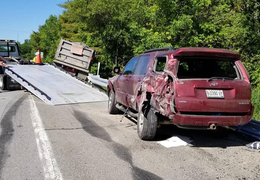 A dump truck carrying a load of reclaimed asphalt slammed into the left rear of this SUV Wednesday morning.