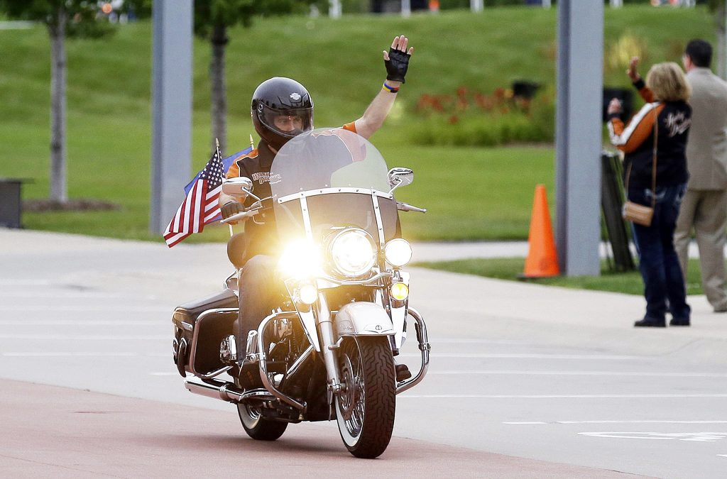 Wisconsin Gov. Scott Walker rides a Harley-Davidson motorcycle in 2013. Walker owns a 2003 Harley Road King  that he's driven across the state to promote tourism and his own political ambitions.