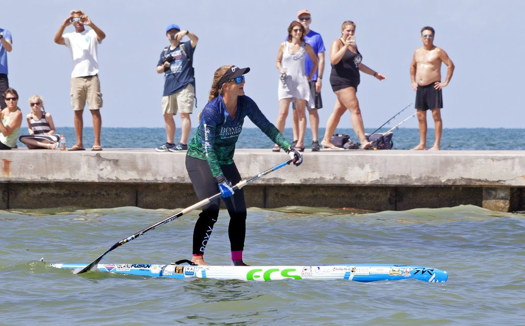 Victoria Burgess, 34, paddles the last few hundred feet to Key West, Fla., from Cuba Wednesday. It took Burgess nearly 28 hours to make the approximately 100-mile voyage across the Florida Straits.