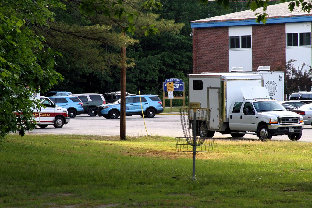 Police were using Mountain Valley High School in Rumford as a staging area Friday as they searched for a suspect in the killing of a woman in Berlin, N.H.