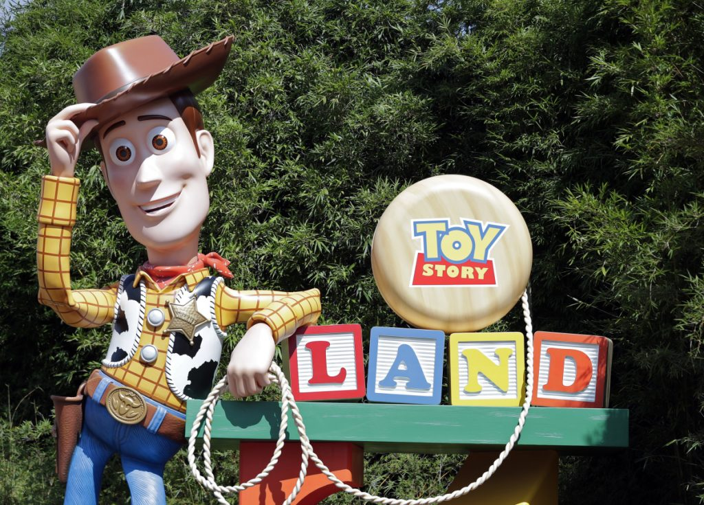 A statue of the character Sheriff Woody greets visitors at the entrance to Toy Story Land in Disney's Hollywood Studios at Walt Disney World in Lake Buena Vista, Fla.