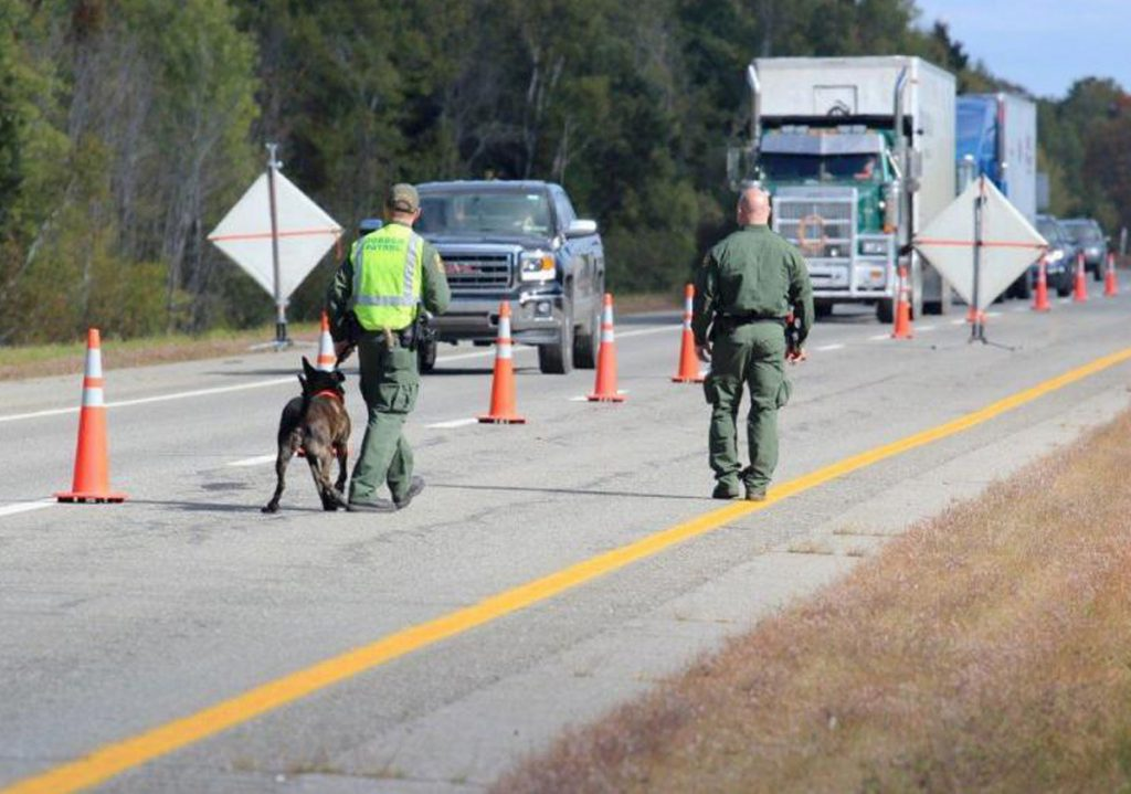 U.S. Border Patrol agents operate a citizenship checkpoint on June 21 along Interstate 95 between the Penobscot County towns of Howland and Lincoln. The federal agency has said it has been increasing its transportation checks across the country.