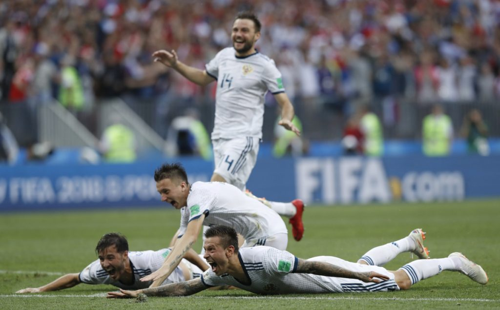 Russia's Fyodor Smolov, right, celebrates with teammates after Russia defeated Spain in a penalty shoot out during their elimination match at the 2018 World Cup in Moscow, Russia on Sunday.