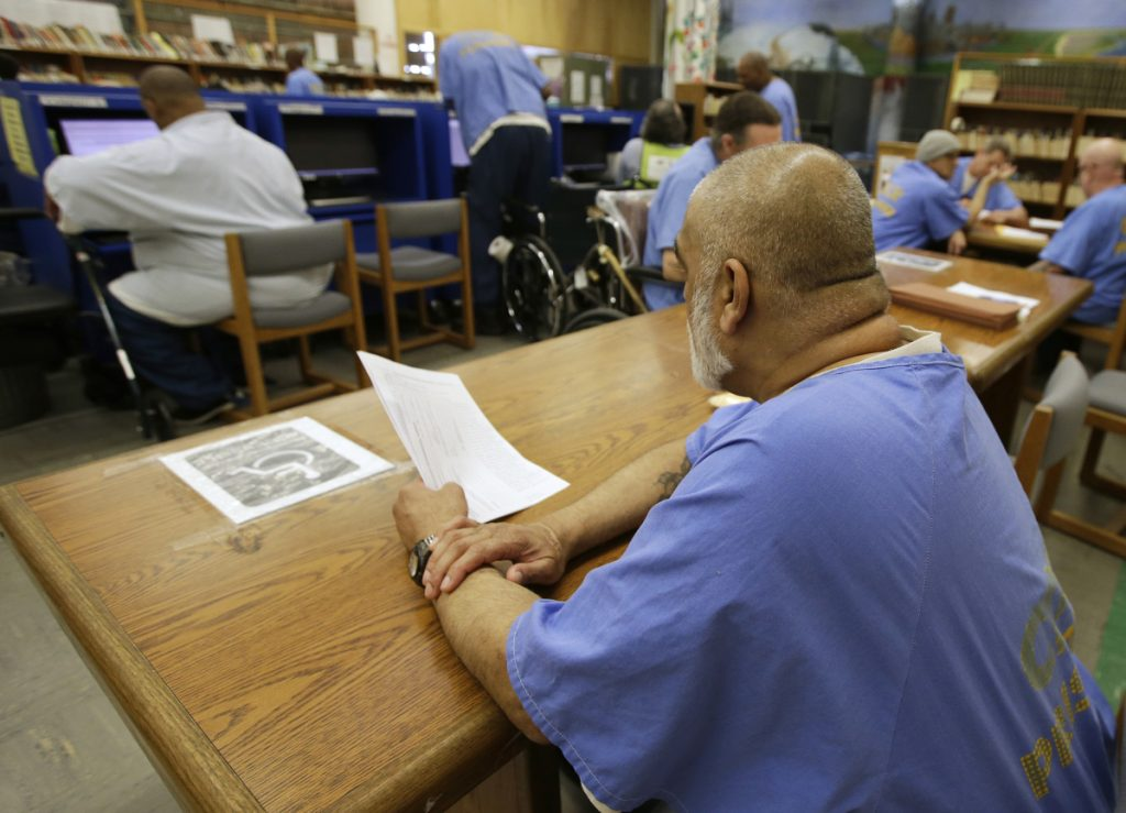 Inmates use the library at the California Medical Facility in Vacaville, Calif. The facility is one of the California prisons where general population inmates are expected to peacefully coexist alongside inmates formerly housed at so-called Sensitive Needs Yards.
