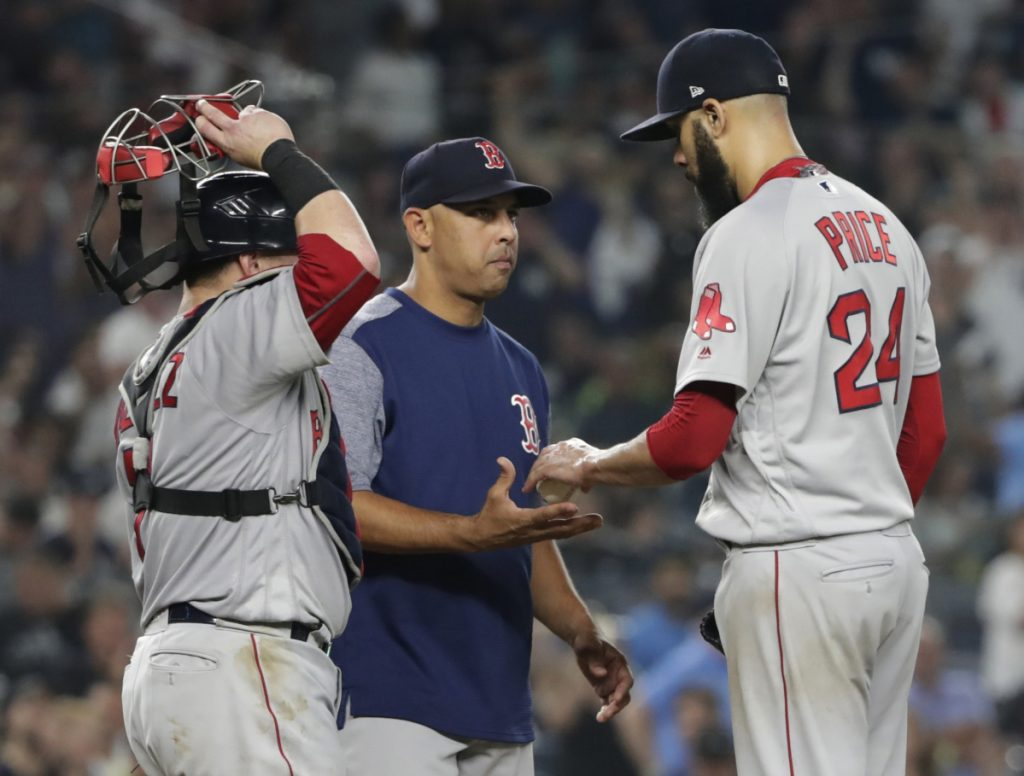 David Price of the Red Sox hands the ball to Manager Alex Cora while leaving in the fourth inning Sunday night. Price gave up five home runs in 3  innings.