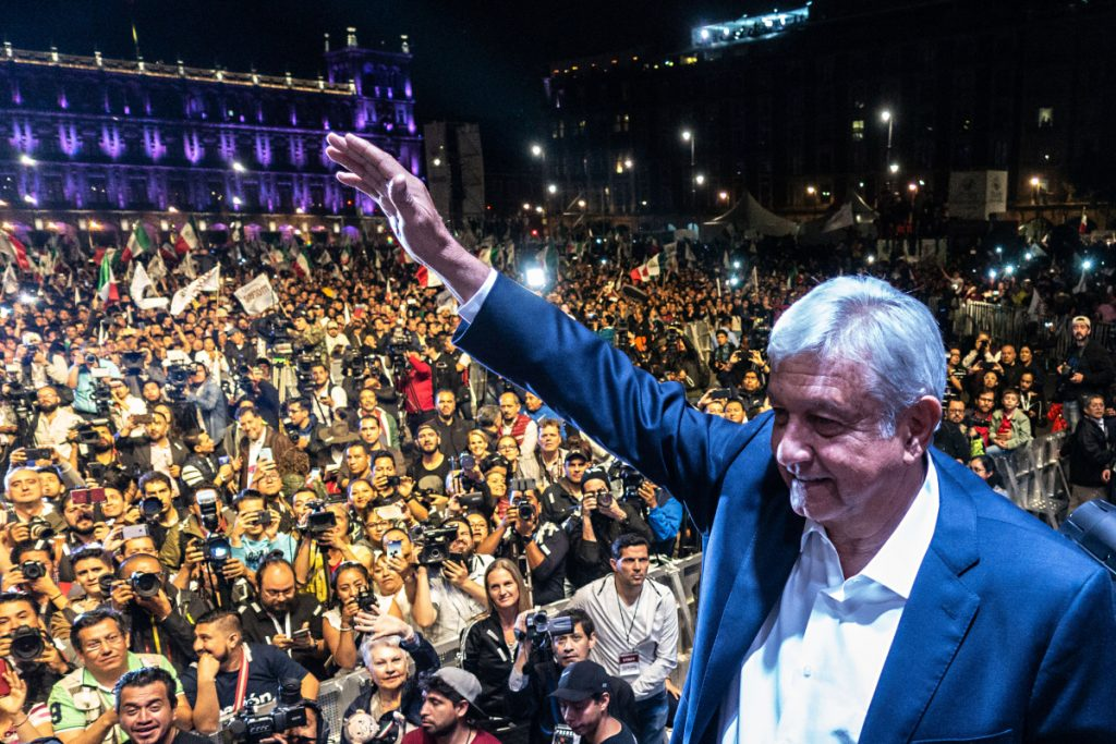 Andres Manuel Lopez Obrador, winner of Mexico's presidential election, waves during a rally at Zocalo square in Mexico City on July 1.