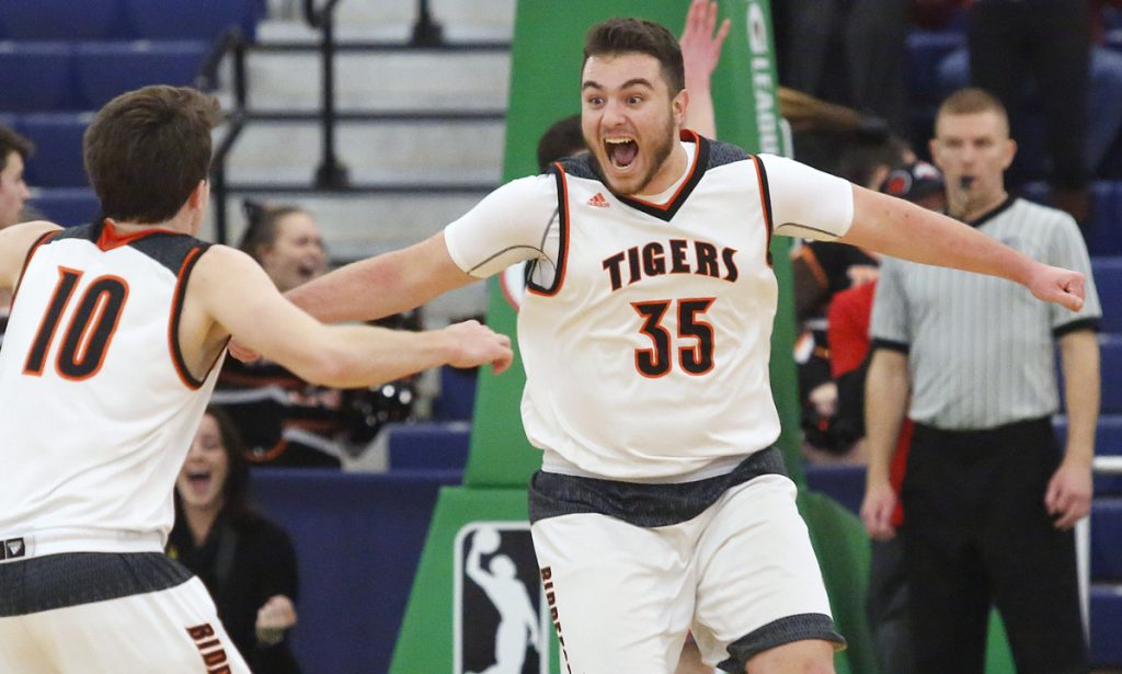 Zach Reali, right, celebrates with teammate Carter Edgerton after his buzzer-beating putback – his only basket of the game – gave Biddeford a 50-48 win over Brunswick in a Class A South quarterfinal in February.