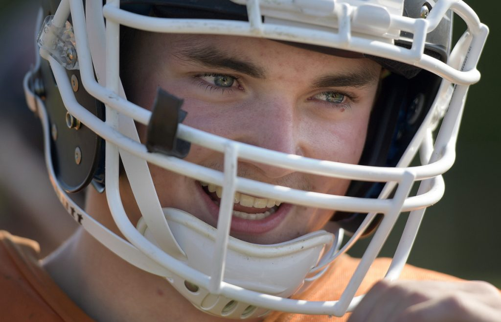 Staff photo by Andy Molloy   Gardiner safety Kolton Brochu laughs during practice Tuesday at the high school.