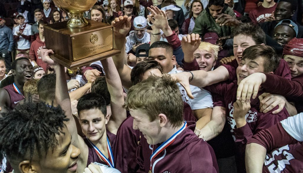 Edward Little point guard Tyler Morin hoisted the Gold Ball as the Red Eddies celebrated their win over Scarborough for the Class AA basketball championship.