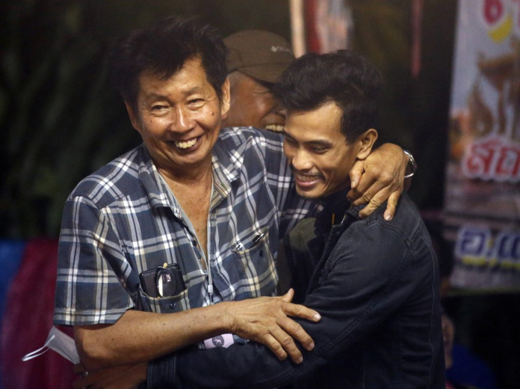 Family members smile after hearing the news that the missing 12 boys and their soccer coach have been found alive, in Mae Sai, Chiang Rai province, in northern Thailand on Monday.