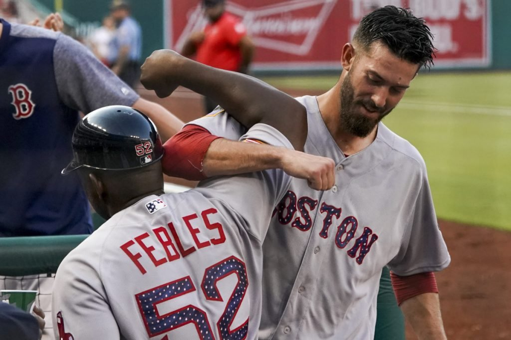Red Sox starting pitcher Rick Porcello, right, celebrates with third base coach Carlos Febles after Porcello hit a three-run double during the second inning of the Red Sox' 4-3 win over the Nationals on Monday in Washington.