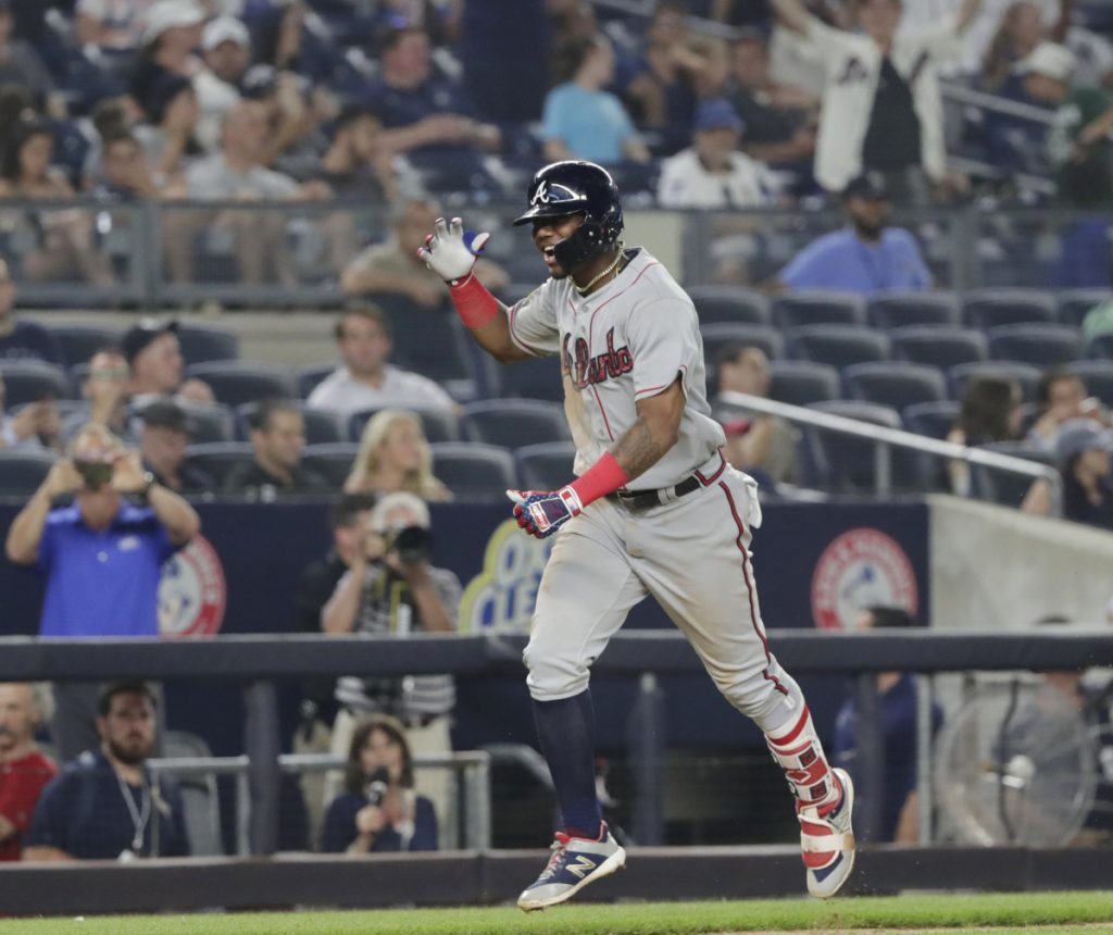 Ronald Acuna Jr. celebrates as he runs the bases after hitting a two-run home run in the 11th inning to lift the Braves to a 5-3 win over the Yankees on Monday in New York.