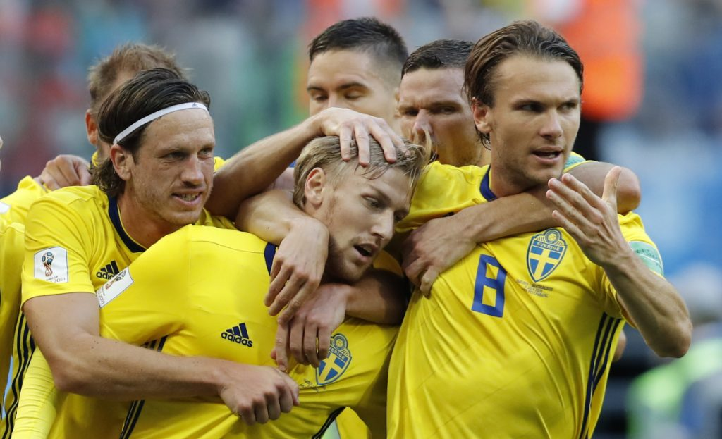 Sweden's Emil Forsberg, center, celebrates with teammates after scoring a goal during the match between Switzerland and Sweden at the 2018 World Cup in St. Petersburg, Russia on Tuesday.