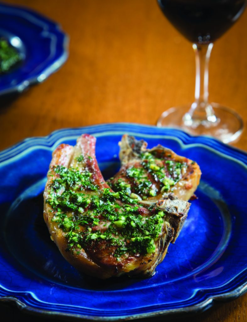 To make the lamb chops, build a medium-sized fire in the barbecue, or light the gas grill using all three burners.