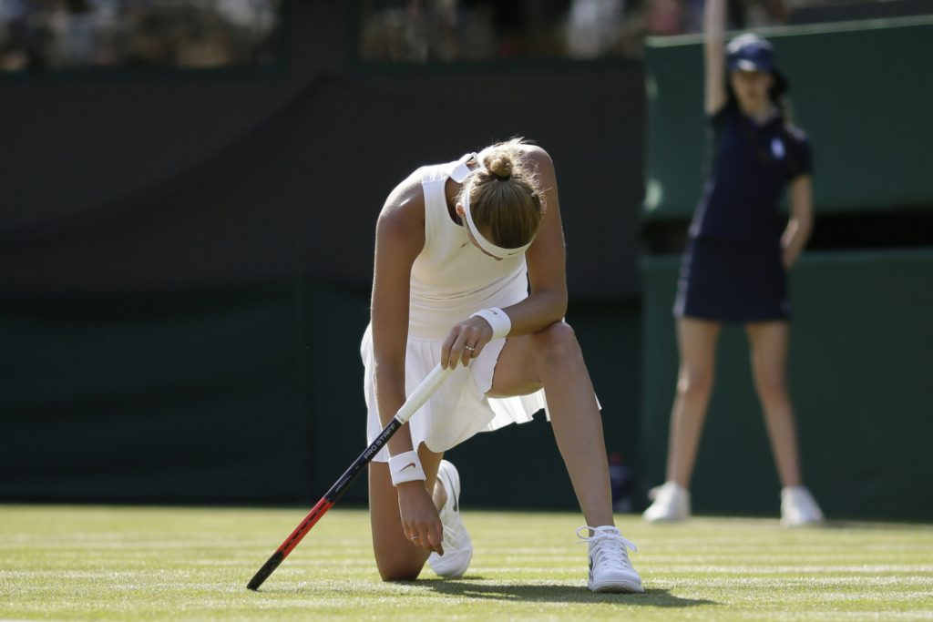 Petra Kvitova, a two-time champion at Wimbledon, was knocked out of the tournament in the first round on Monday, losing to unseeded Aliaksandra Sasnovich.