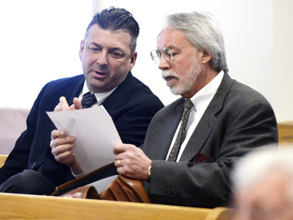Former Ogunquit Town Manager Thomas Fortier, left, confers with attorney Bruce Merrill in March. A York County jury could not reach a verdict in the initial case on theft and official suppression charges.