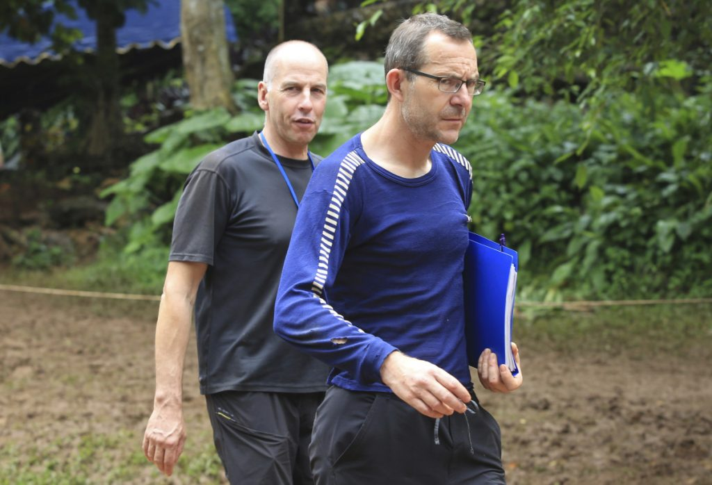 Richard Stanton, left, and John Volanthen arrive in Mae Sai, Chiang Rai province, in northern Thailand, on Tuesday. They found the 12 boys and soccer coach in a partially flooded cave in northern Thailand, where they had been lost for 10 days.