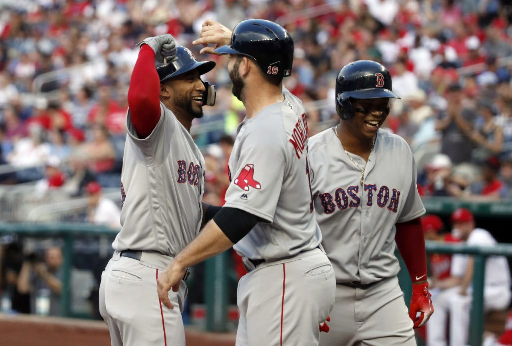 Boston's Eduardo Nunez, left, celebrates knocking in Mitch Moreland and Rafael Devers with a three-run homer in the second inning Tuesday night in Washington.