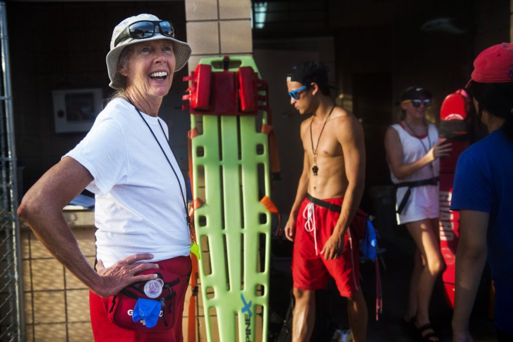 Leslie Botts and her fellow lifeguards close the Balcones neighborhood pool in Austin for the evening.