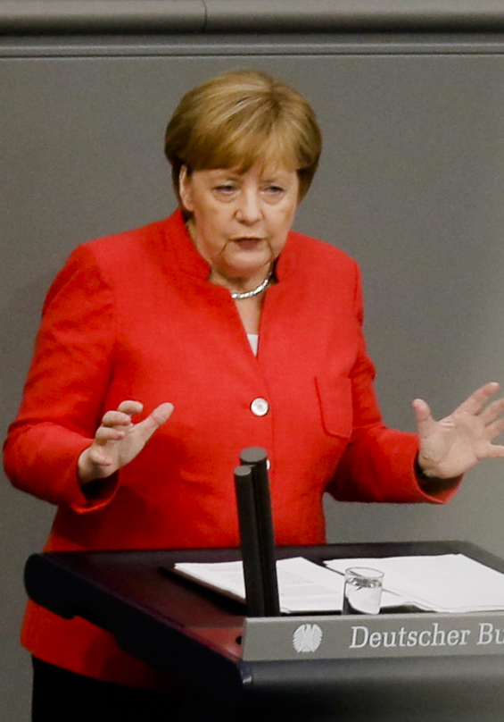 Chancellor Angela Merkel makes points Wednesday during a budget debate at the German parliament.