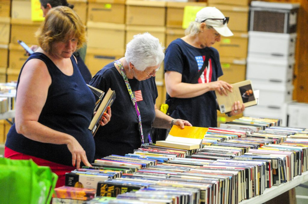 Shoppers look for books Wednesday during the annual Friends of Belgrade Library book sale in the Center for All Seasons in Belgrade.