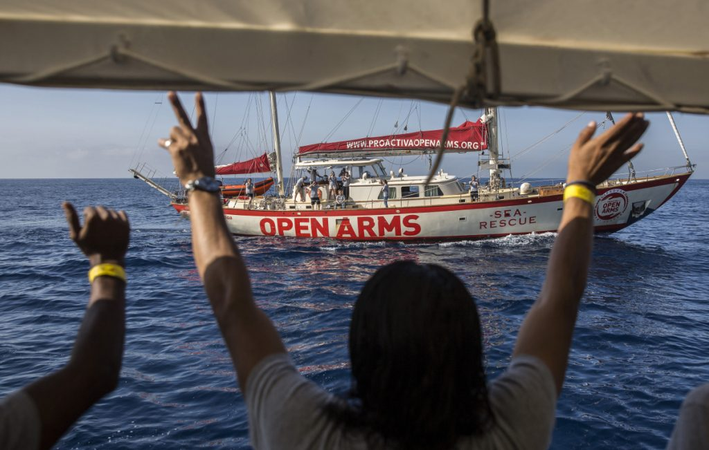 The Open Arms approach to Barcelona is followed by lawmakers aboard the Astral, a sister boat run by the same organization on Wednesday.