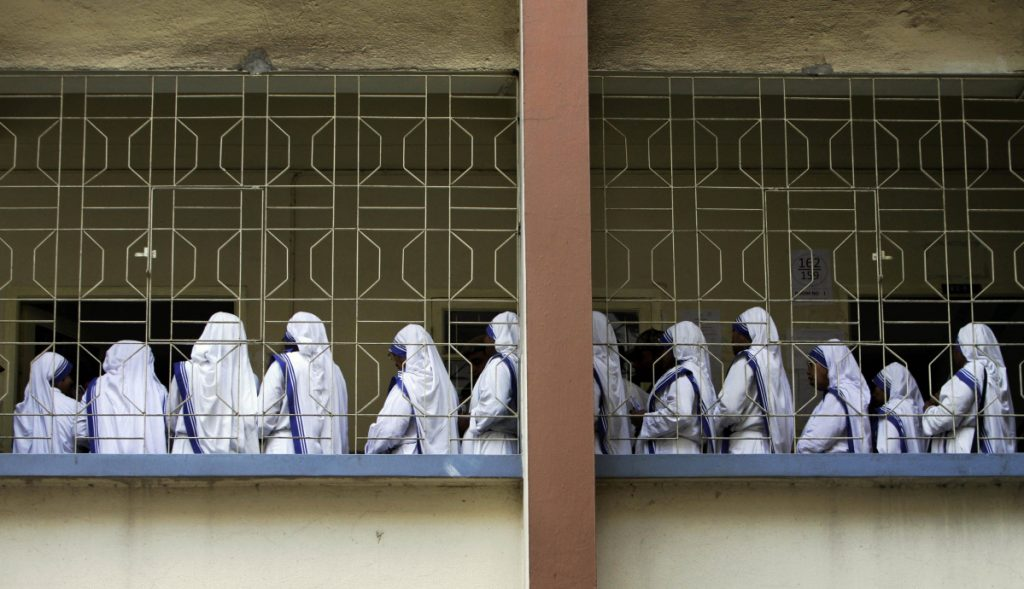 Nuns of Missionaries of Charity, the order founded by Mother Teresa, stand in a queue to cast their vote during an election in Kolkata, India. Police say they have arrested a nun and another worker at a shelter run by Mother Teresa's charity for allegedly selling a baby.