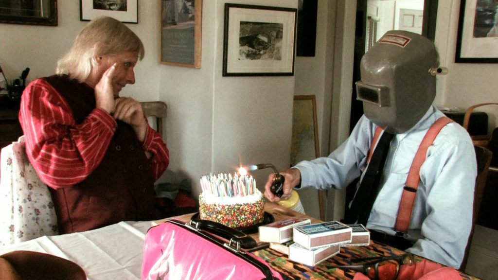 The humble Farmer lights the candles on a recent birthday cake.