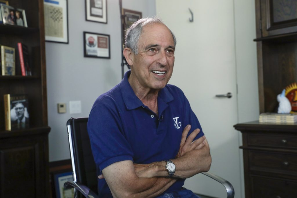 Attorney Lanny Davis speaks during a 2018 interview in his K Street office in Washington. Donald Trump's longtime personal lawyer and fixer Michael Cohen has added Davis, a former attorney for Bill Clinton, Martha Stewart and Jerry Sanduksy, to his legal team.