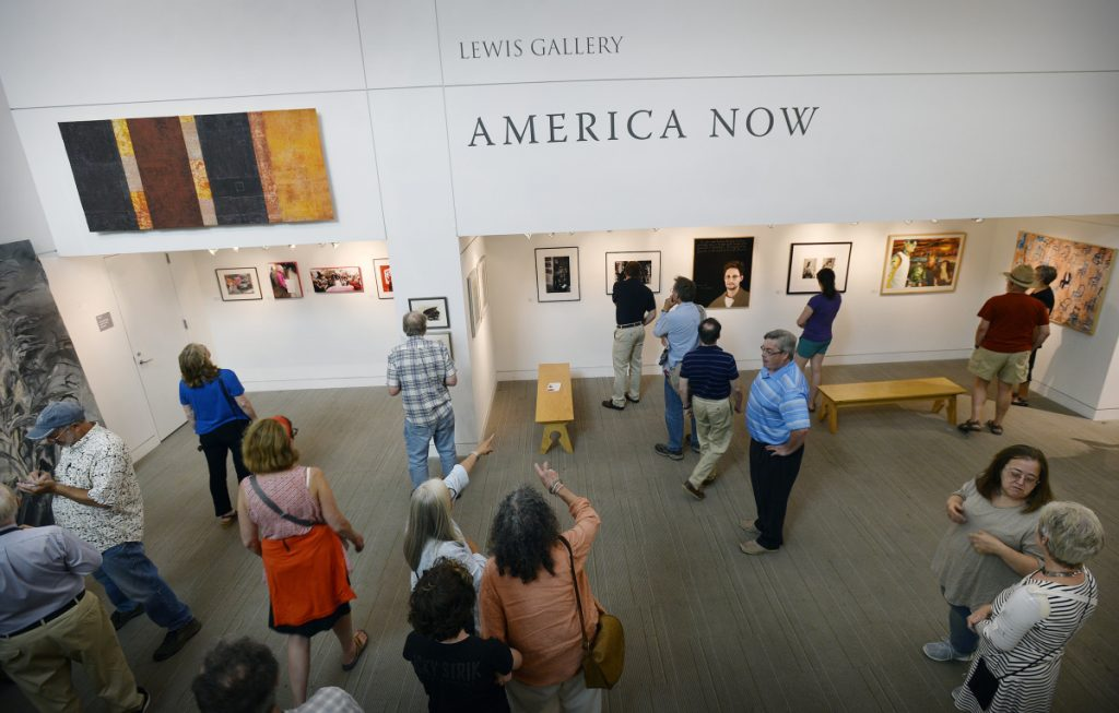 The crowd looks over the work at the America Now Exhibit at the Portland Public Library on Friday.