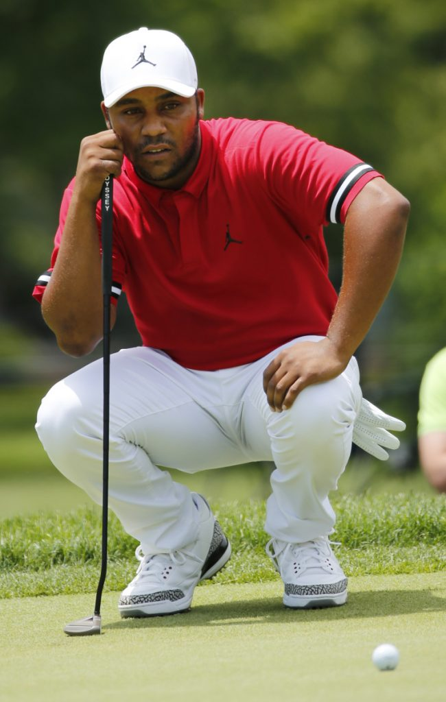 Harold Varner III shoy a 4-under 66 to grab a share of the lead at the Military Tribute at The Greenbrier on Saturday.