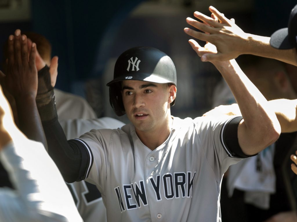 Tyler Wade celebrates Sunday after scoring the 10th-inning run on Brett Gardner's single that lifted the New York Yankees over the Toronto Blue Jays, 2-1.