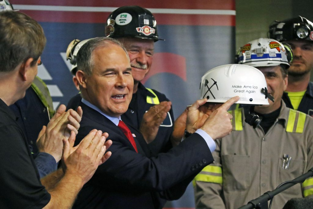 Then-EPA Administrator Scott Pruitt holds up a hardhat he was given during a visit to a coal mine in Sycamore, Pa., in April 2017. A reader warns that his potential successor would continue the culture of cronyism and corruption that Pruitt fostered at the agency.