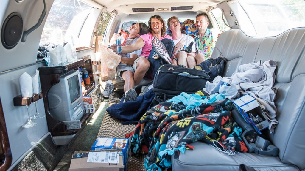 Jamming into the back seat of their newly purchased limo at Shaker Hill Outdoors in Poland, the four friends prepare to set out on a 48-state road trip in the hope of getting to meet Ellen DeGeneres. From left are David Sosna, Ty Gatewood, Jake Triplett and Kyle Brown.